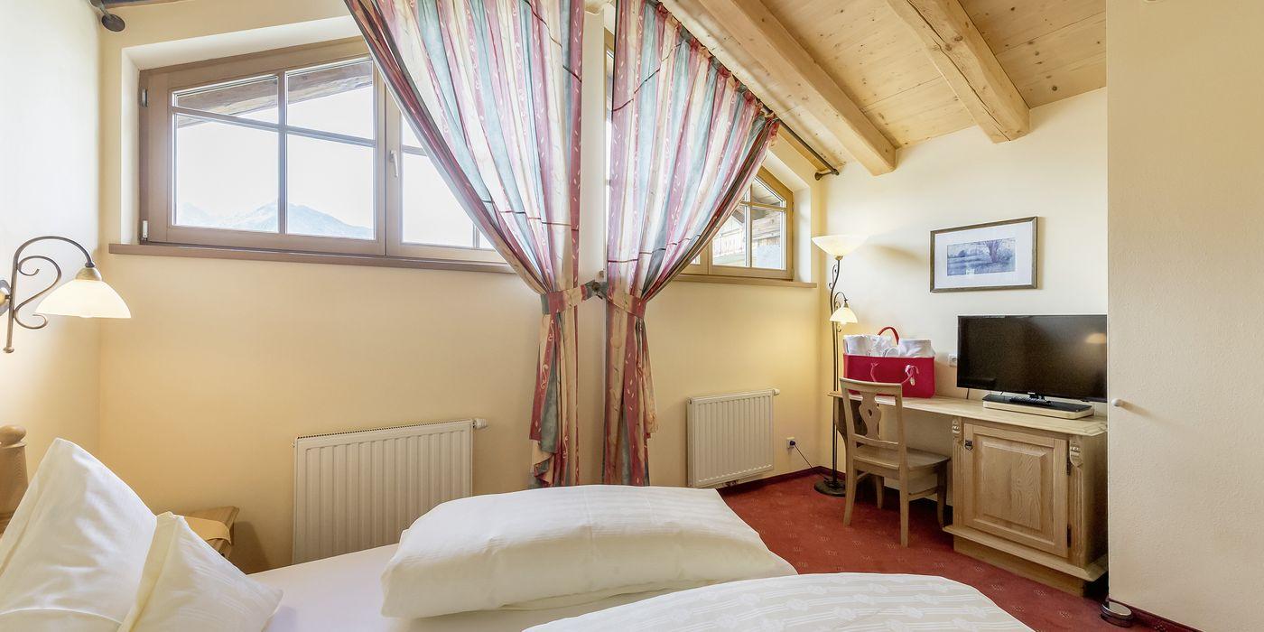 """Comfy bedroom in the """"Die Pinzgauerin"""" apartment"""