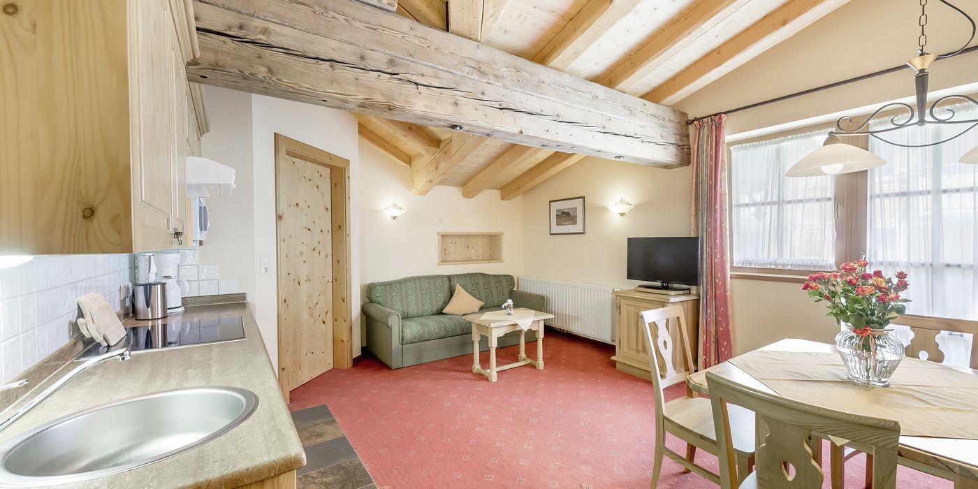 """Living room/kitchen in the """"Die Pinzgauerin"""" apartment"""