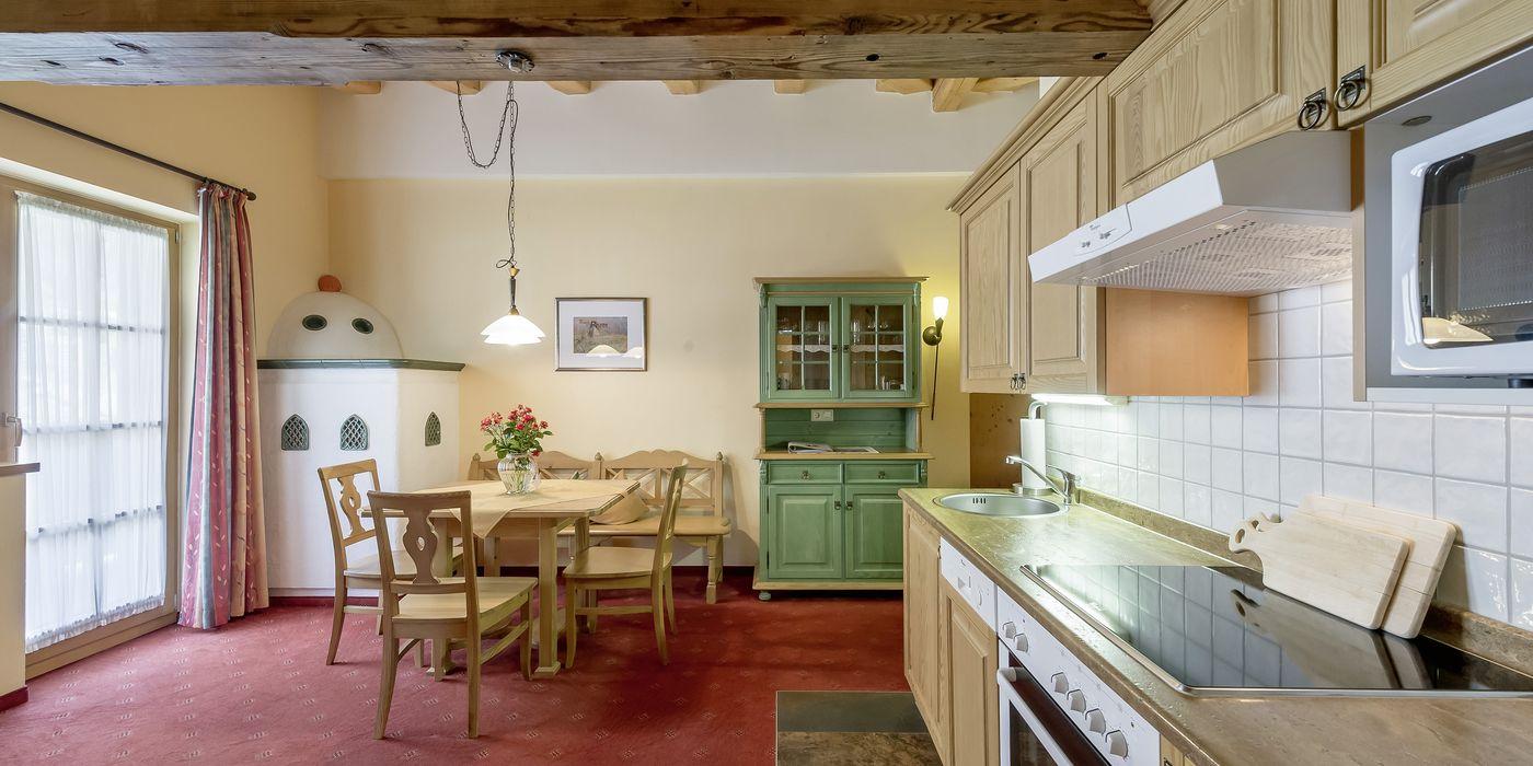 """Living room/kitchen in the """"Die Pinzgauerin"""" apartment in Kühtai"""